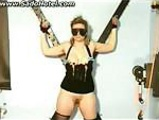 Slave tied to a wall gets clamps on her nipples and her