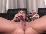Fantastic cutie is pissing and rubbing smooth pussy