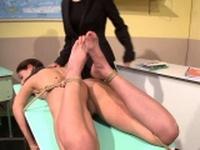 Restrained schoolgirl dildoed by lesbo femdom
