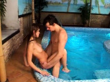 Poolside, these two teens are getting very naughty. It