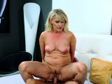 Blonde mature woman rides