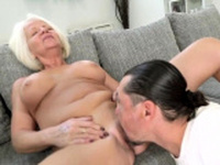 Busty blonde GILF admiring a hard dick