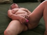 Granny Masturbates On The Bed With Her Toy