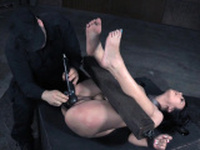 Busty sub restrained and whipped before toyed