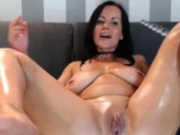 Brunette masturbating and squirting solo on w