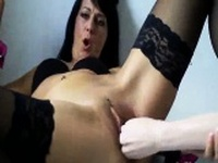 Horny milf fucks a huge bottle and rubber fist