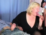 Two guys fuck busty granny from both sides