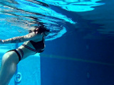 Big tits Sheril goes underwater naked