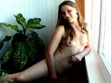 Brunette with small tits kneeling and masturbating