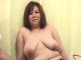 Busty Japanese tart fingering cunt sucking cock