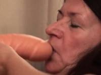 Granny loves fucking her big toy and show it all
