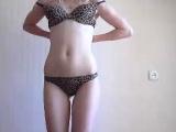 Brunette in lingerie does a striptease