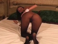 Attractive nympho exposes hairy twat in transparent tights