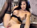 Stockings clad busty slut toys